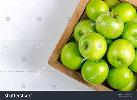 green apple great english 8853004231 apple on white table backgroundgreen apple stock photo