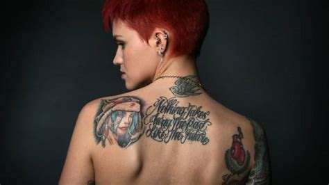 ruby rose tattoos neck three different tattoos on ruby on the back of