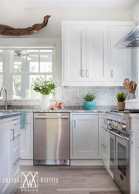 white kitchen cabinets with white backsplash white cabinets with white marble hex backsplash cottage kitchen