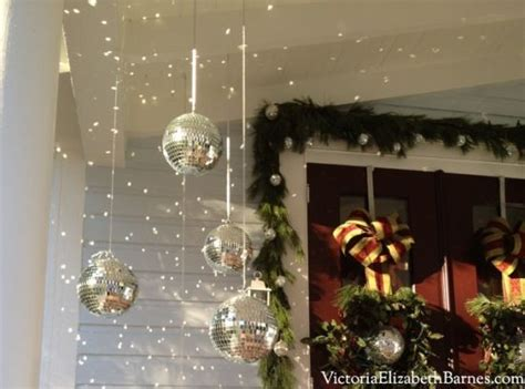 using mirror balls as front porch decorations evergreen