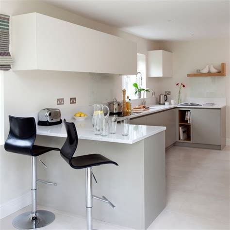 The silestone worktop in this modern kitchen overhangs here to create
