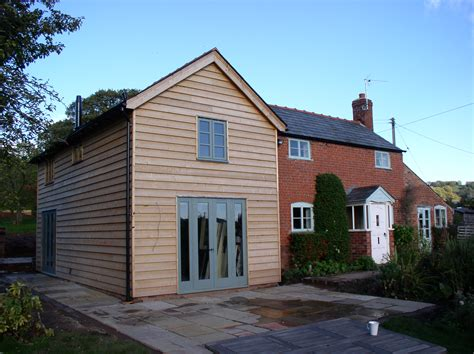 Cottage Kitchen Extensions by Oak Frame And Weatherboarded Extension To A Brick Cottage