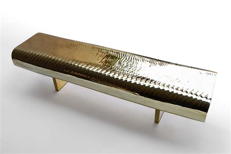 designboom benches a brass bench with ripples like the surface of water curbed