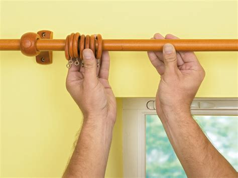 installing drapery rods how to install a curtain rod on window casing how tos diy
