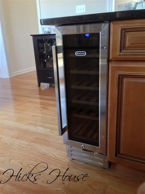 built in wine fridge i like how it s on the end cap and