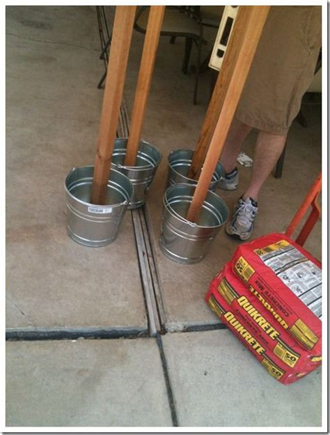 diy string light post party on the patio patio string lights and buckets