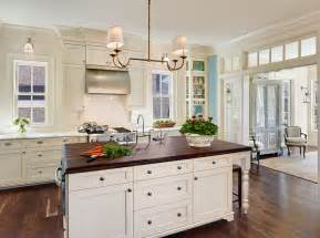 white kitchen wood island inspired white shaker cabinets vogue charleston traditional kitchen inspiration with crown