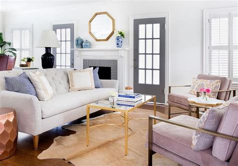 chic living room features a light gray linen tufted sofa