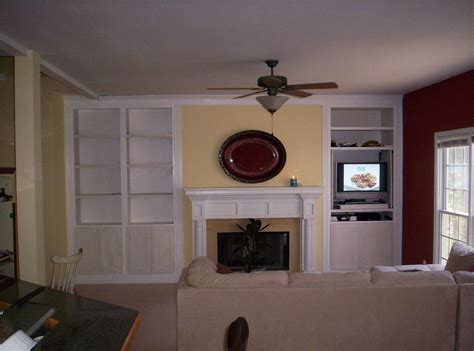 hand crafted painted built in tv cabinetry by tony o tv built ins transitional living room burnham design