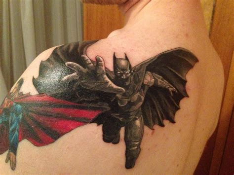 batman tattoo on back of shoulder with bats going over to the next part of my superhero sleeve batman on my left