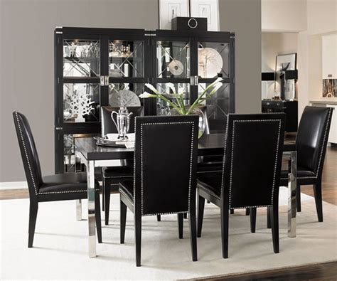 simple dining room with black table and black chairs with