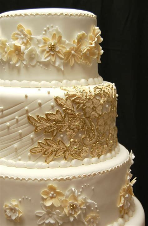 gold and white wedding cake   ** All Things Wedding