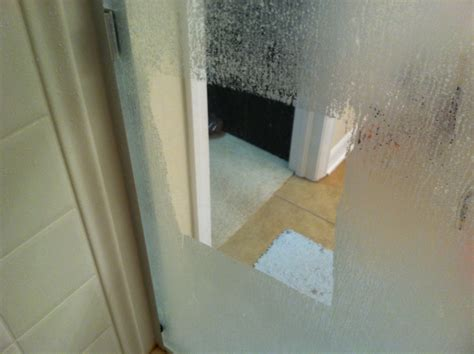 Cleaning A Shower Door Easiest Way To Clean Glass Shower Doors Soak Paper Towels In White Vinegar Stick Them To The