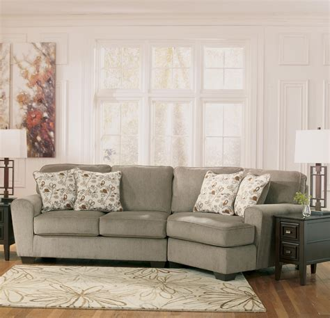sectional sofa with cuddler ashley furniture patola park patina 2 piece sectional