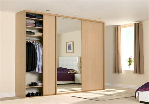 three door sliding wardrobe with center mirror id566