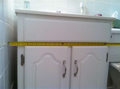 how to fill gap between cabinet and floor gap between vanity and wall