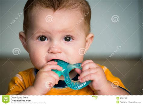 baby teething chew baby chewing on teething ring stock photo image 42681703