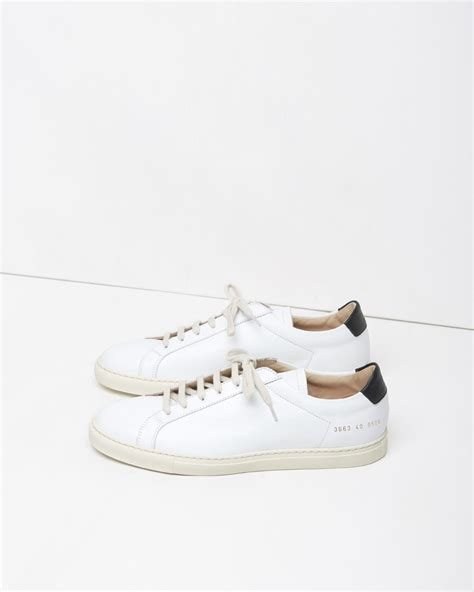 by common projects sneakers lyst common projects retro achilles low sneaker in white