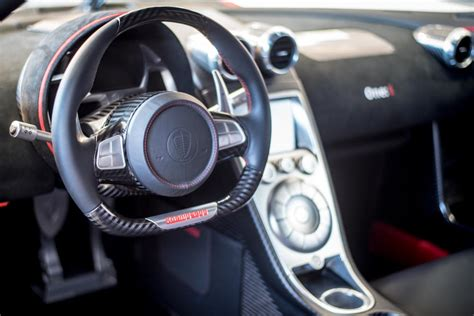 white with red accents koenigsegg one:1 steering wheel