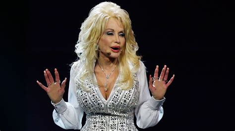 dolly partons tattoos dolly parton s and arms are covered in secret tattoos