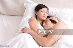 How To Cuddle With A In Bed by Cuddling On Bed Stock Photo Getty Images