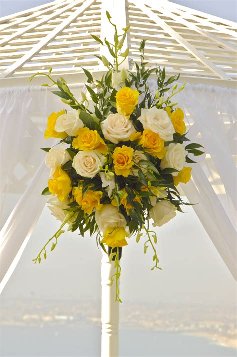 yellow wedding arch flowers