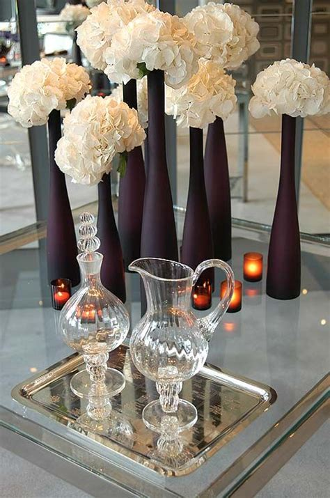Frosted Purple Vases Of Varying Heights Are Accented With Frosted Vases Centerpieces