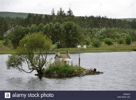 house on an island a toy house on an island on loch shin at lairg highland scotland stock photo