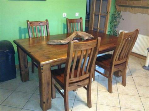 solid chunky wood rustic table and 4 chairs for sale
