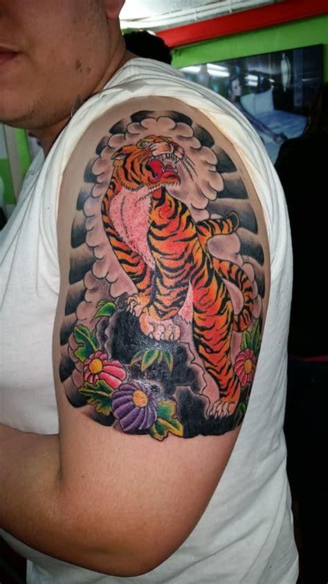tattoo nyc village japanese tiger tattoo on left arm yelp