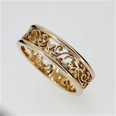 wide filigree ring made from yellow gold from