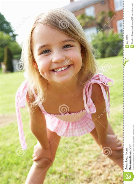 Portrait Of Young Girl Standing In Garden Stock Photos Image