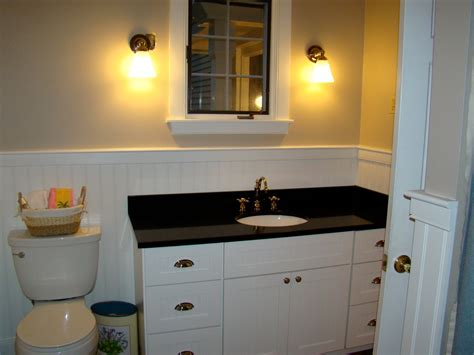 bathroom awesome bathroom vanity ideas with white wainscoting and black counter top plus white