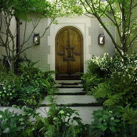 charleston style courtyard home highland homes bevolo hulsey garden i love the green white without the