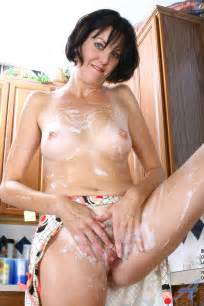 nude housewife shows off her milf breasts and her dripping pussy in