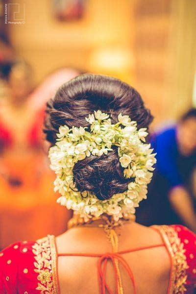 Indian Wedding Bun Hairstyles With Flowers by Best 25 Indian Bridal Hairstyles Ideas On