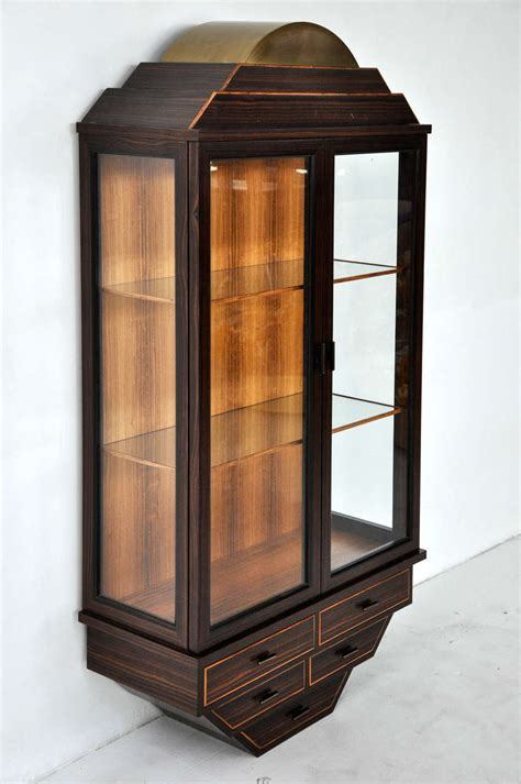 wall curio display cabinet rosewood and brass wall hanging curio cabinet at 1stdibs