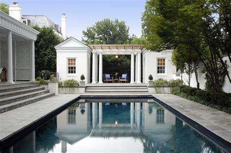 pool house addition  raised terrace creates stunning