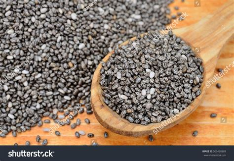 Chia Brown chia seed on brown wooden table stock photo 505438888