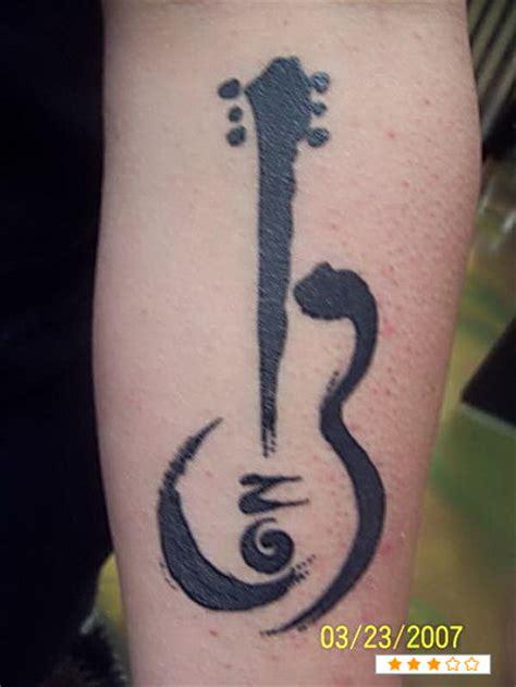 tattoo guitar hand music guitar tattoo on hand tattooshunt com