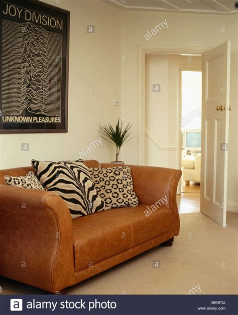 cushions for brown leather tiger and leopard print cushions on brown leather sofa in