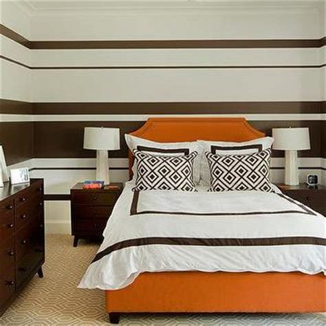 white and brown bedroom with white bamboo 4 poster bed