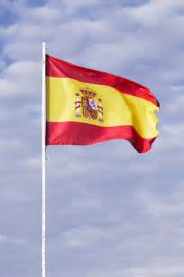 spanish flag waving   wind stock image image
