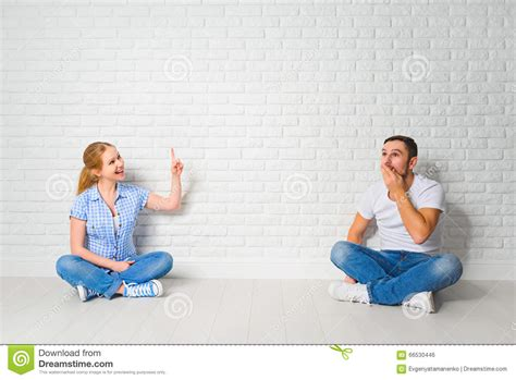 mortgage housing concept of mortgage housing problems couple at blank wall stock photo image 66530446