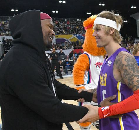 justin bieber bench in pictures justin bieber quavo and other stars in nba