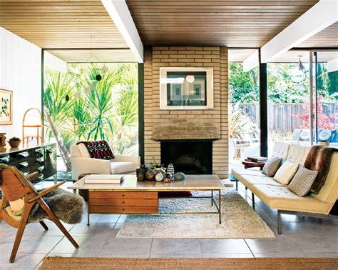 mid century modern at home 0500519579 in the living room of a classic eichler a travertine topped coffee table by paul mccobb pairs