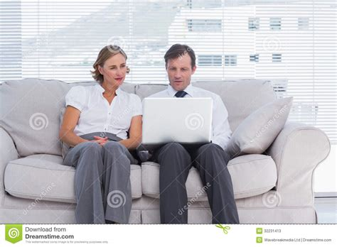 couch people business people sitting on couch and using laptop stock