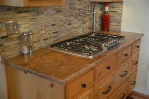 nice Kitchen Backsplash Designs Photo Gallery #6: madura-gold-granite-countertops-232916.jpg