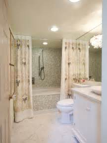 Small bathroom with mosaic tile and lavender print shower curtain