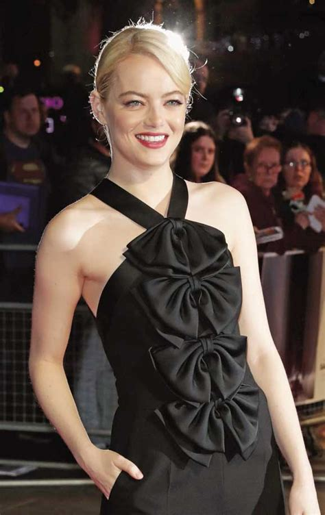 emma stone earnings emma stone shows off four earrings in a givenchy jumpsuit